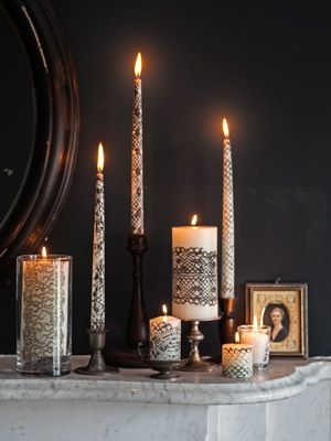 paint lace black and roll inexpensive tapers/pillars over it to transfer pattern