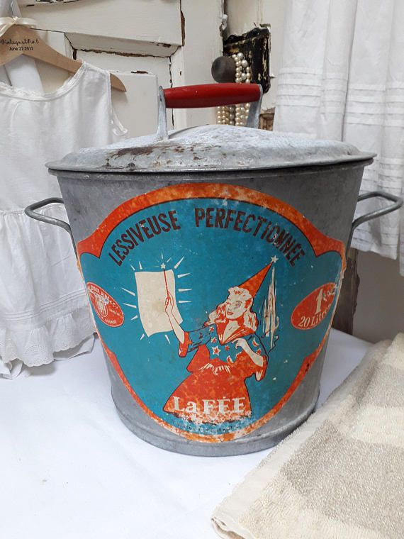 Superb French galvanised laundry bin with The Fairy motif on