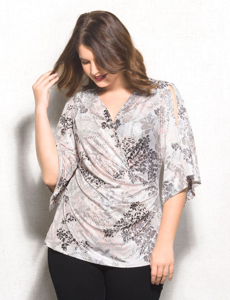 We'll always take the opportunity to shine! For our next party, we're putting this shimmery, super-flattering top on our guest list. Allover black, white, gray and pink scroll print with silver hologram dots. Domestic.