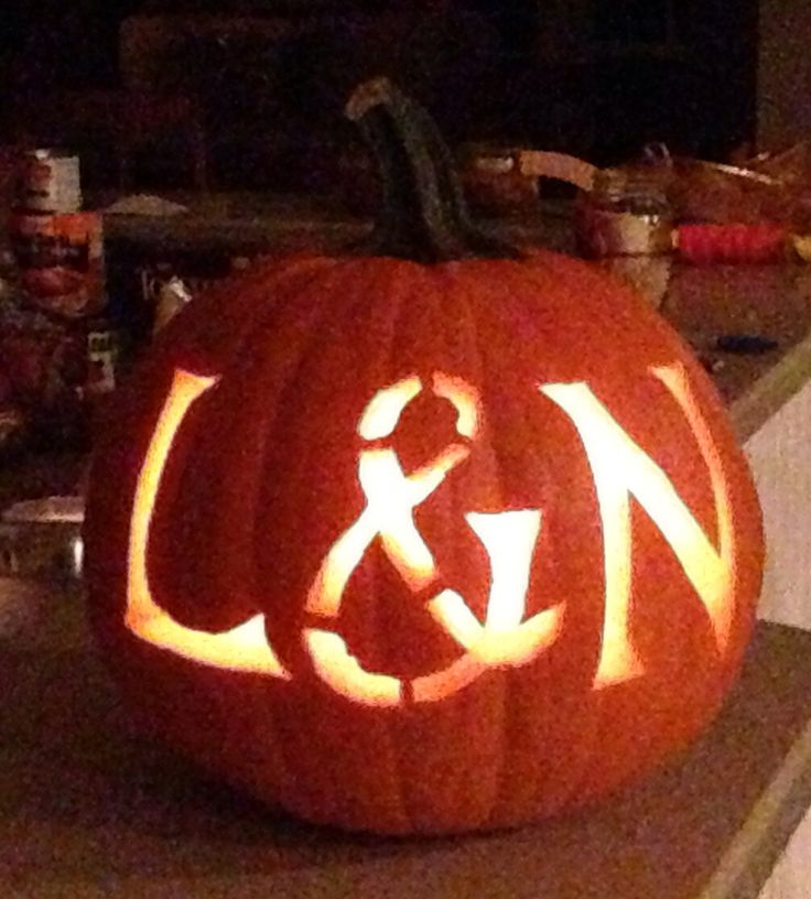Initials of the engaged couple, carved in a pumpkin, for their fall engagement party! Everyone loved it!