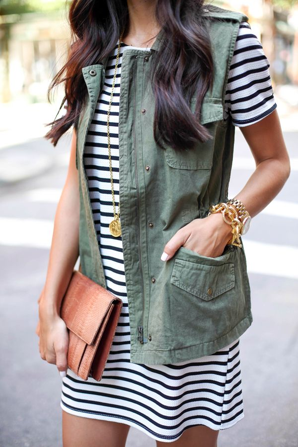 Spring / Summer - round neck stripped summer dress + olive green utility vest + brown clutch + golden bracelets