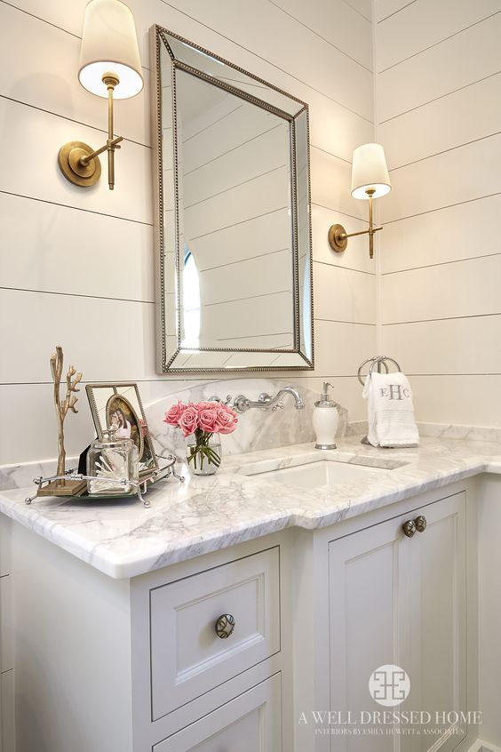 A Beautiful Neutral Bathroom Featuring White Shiplap Walls, A White Vanity,  Gray And White Granite Counter Top With A Marble Look, And An Antique Gold  Trim ...