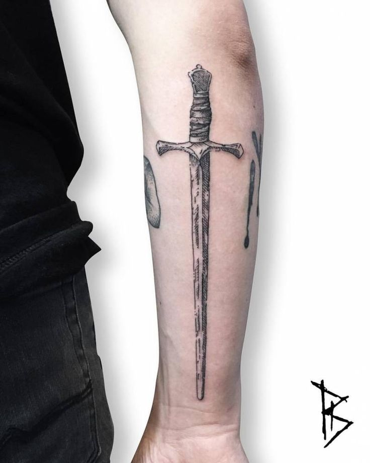 Engraving style sword tattoo on the right forearm.