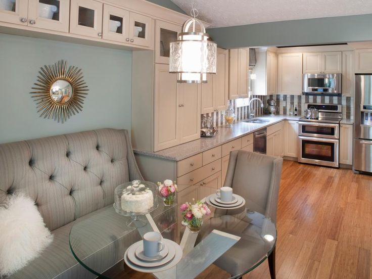 Maple cabinets with an Irish creme finish, quartz countertops and Valspar Seafoam Storm paint give the open kitchen, dining and living room a serenely sophisticated vibe. Natural bamboo flooring runs throughout all three spaces.