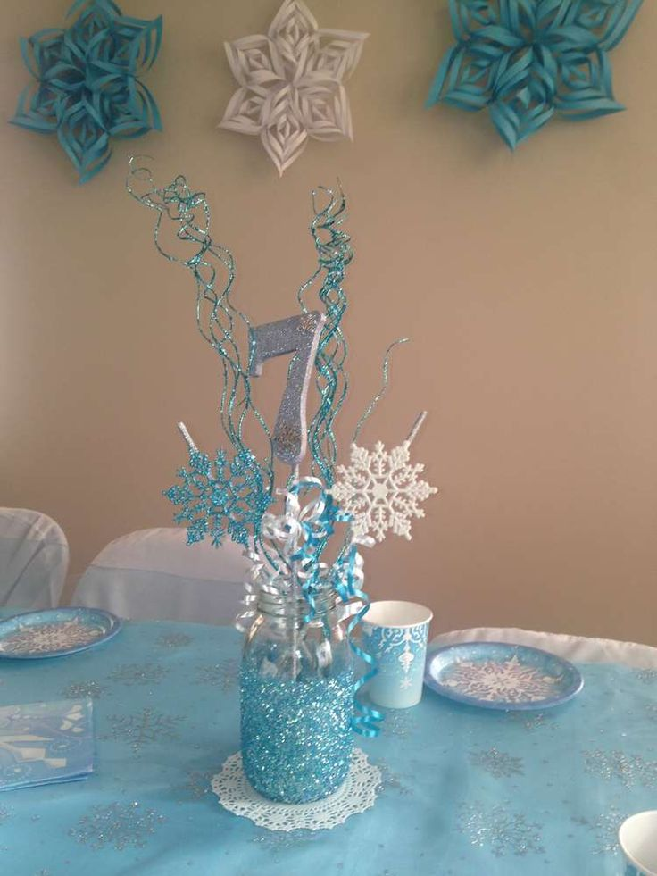 Mason jar centerpiece at a Frozen birthday party! See more party ideas at CatchMyParty.com!
