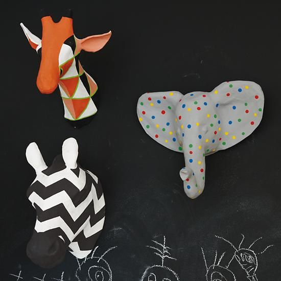 We've discovered three new species in the paper mache animal kingdom: The polka dotted elephant, the chevron zebra and the triangular giraffe. They're handmade, brightly patterned and native only to The Land of Nod.