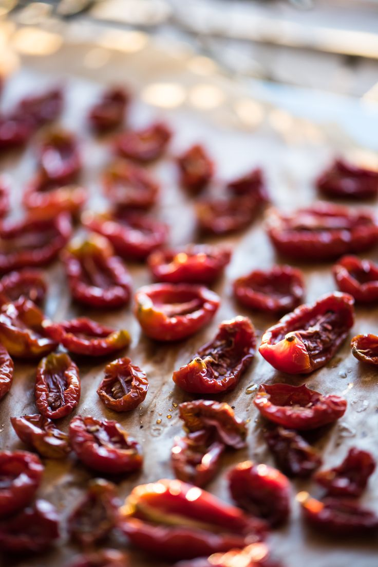 My version of (sun) dried tomatoes. Turn on your oven to 120ºC, slice each tomato in half, sprinkle with salt, pepper, a pinch of sugar and herbs of choice. Then let them dry for at least 3 1/2 hours (depending of oven efficiency, tomato variety, desired consistency). Enjoy!   Mel's Vittles