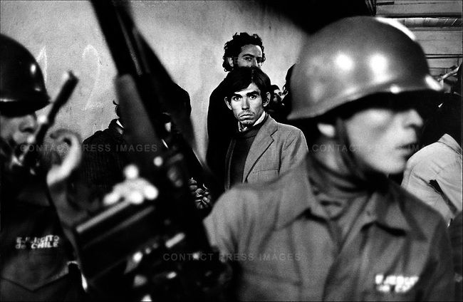 """Daniel Cespedes, a suspected """"leftist"""", is taken to the National Stadium after his arrest. In the aftermath of the September 11th Chilean coup, Santiago, Chile, September 1973"""