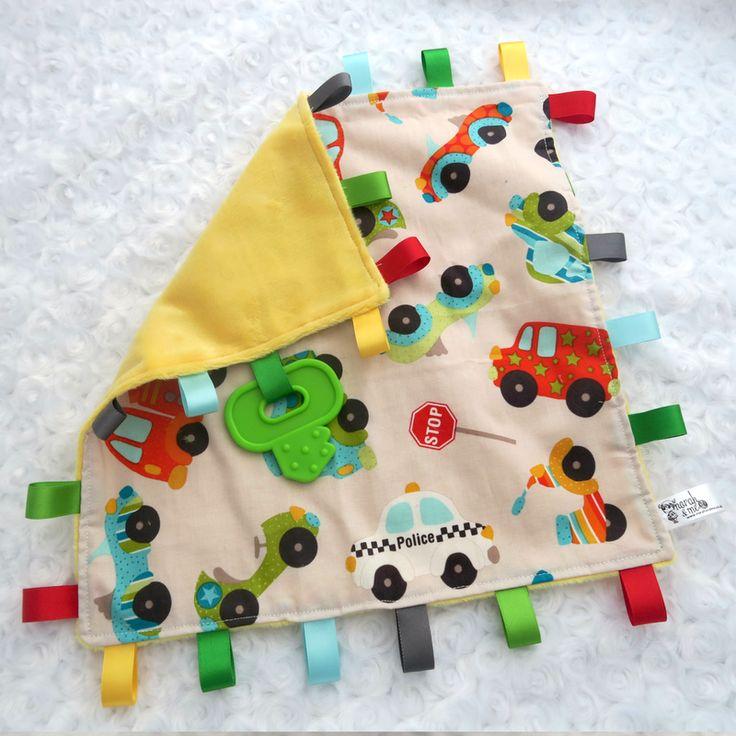 Ribbon tagged teething toy, car transport theme, key shape teether