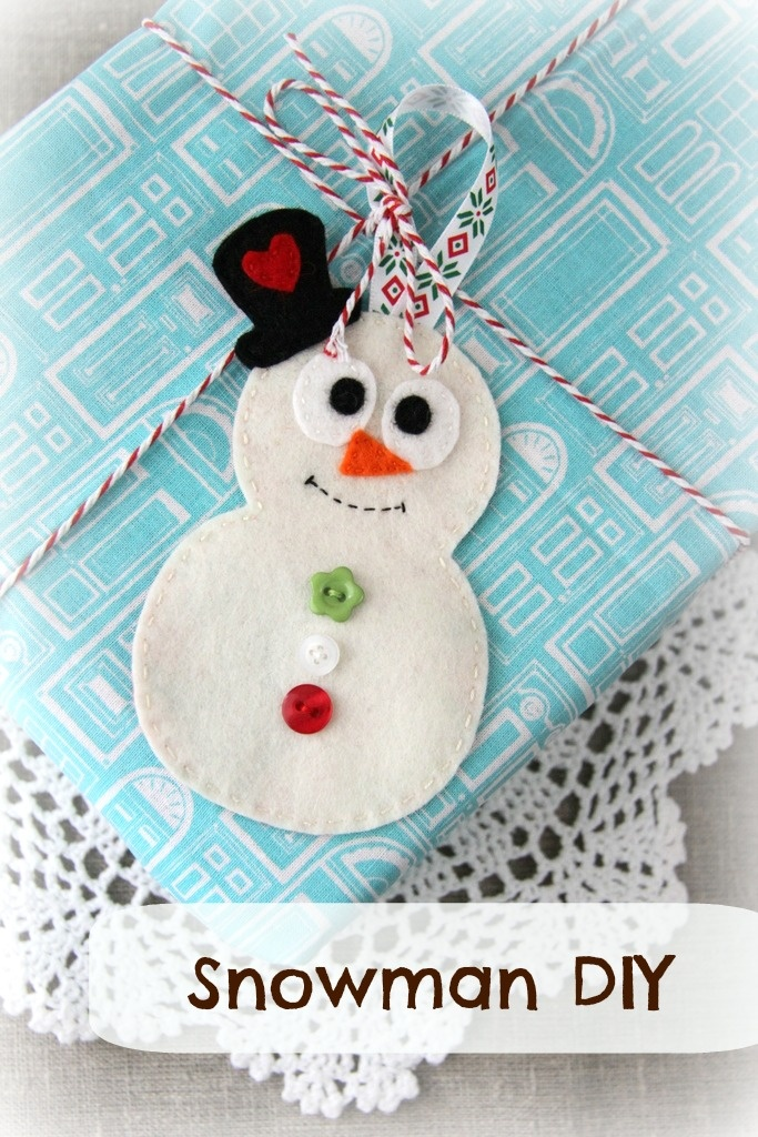 DIY Snowman ~ easily made from felt, fabric scraps and a few little buttons...  He can decorate a Christmas tree or use him to add a handmade touch to your gift wrapping