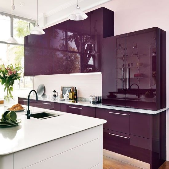 Make a bold statement with a wall of cabinetry in your favourite colour. Deep purple combined with bright white makes an elegant yet eye-catching combination.
