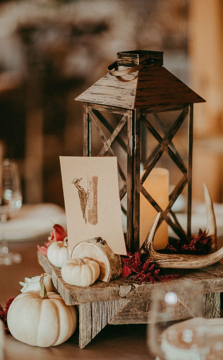 Our Our lanterns and barn wood centrepiece stands look so good with the deep red tones....love it!