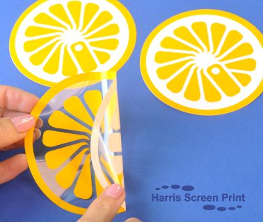 Waterproof stickers screen printed 2 colours onto clear vinyl (one colour is white which sits behind the yellow making the colour extra opaque).