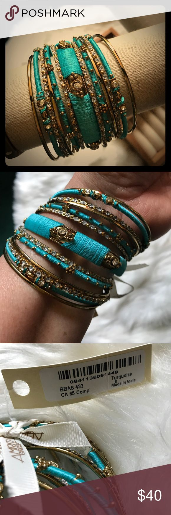 "Amrita Singh 13-piece Ankara Bangle Bracelet Set Amrita Singh 13-piece Ankara Bangle Bracelet Set in gold tone with turquoise silk thread and Austrian crystal details. Size 8"" (20.32 cm). Stacked width is 2"". NWT. Amrita Singh Jewelry Bracelets"