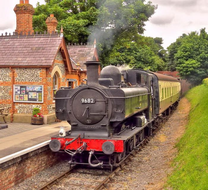 A Great Western Pannier looking right at home hauling a small passenger train through the countryside :)