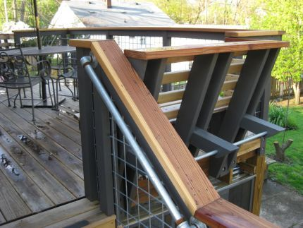 Modern deck on a Craftsman house. Love the details, multi-tiered design and screen room below the deck!