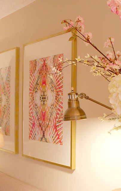 ribba frames sprayed in gold and use fabric as art.