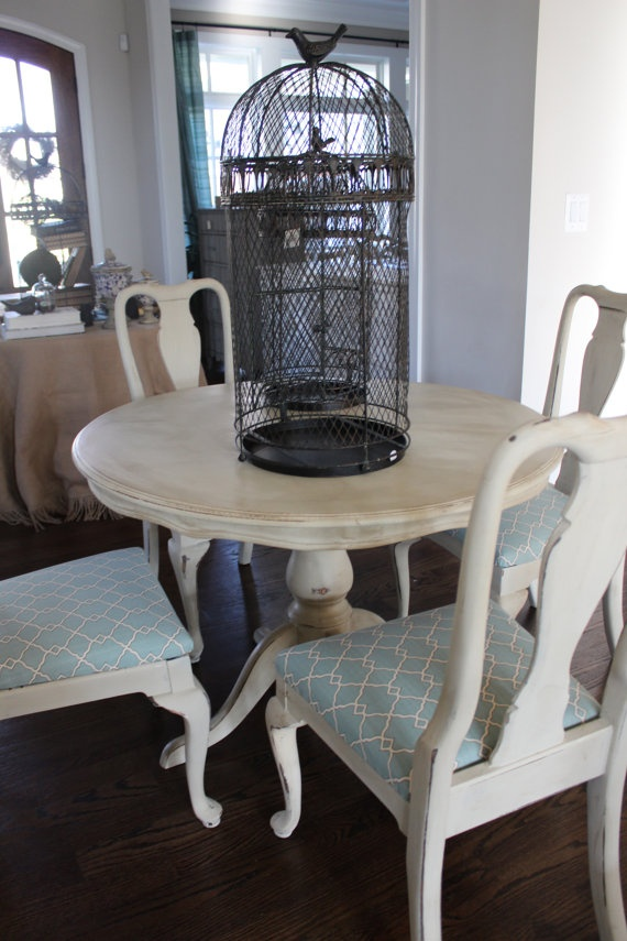 Vintage, shabby pedestal table & chairs. Distressed for an antique look. Chairs are covered in a matching blue & cream lattice.