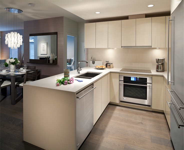 Sail | Optional Ultimate Kitchen: glossy lacquered cabinetry, quartz backsplash, stainless steel appliances