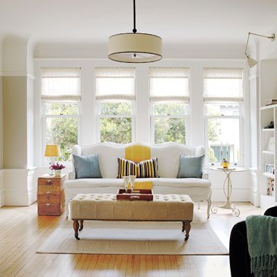 This breezy row house remodel shows how to do an #openplan right. Doesn't it look fresh and inviting? | Photo: James Carrière: Natural Light, Living Room, Lots Of Windows
