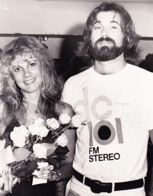 """The date was July 12, 1977 and Gary Chase and I decided to give Christine McVie some roses for her 34th Birthday. We went out to the Capital Center and waited backstage for them after their show. I remember we decided to give Stevie Nicks some roses too, so she didn't feel left out. Well, as this picture was taken, both significant others John and Lindsey were a bit miffed at the radio guys. We learned later, that those were tough times for both couples. We did see the 24 roses in the back…"