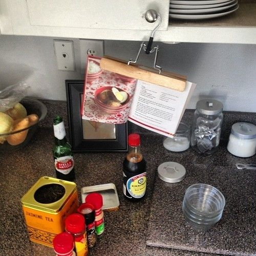 Pants hanger as cookbook holder. | 51 Insanely Easy Ways To Transform Your Everyday Things