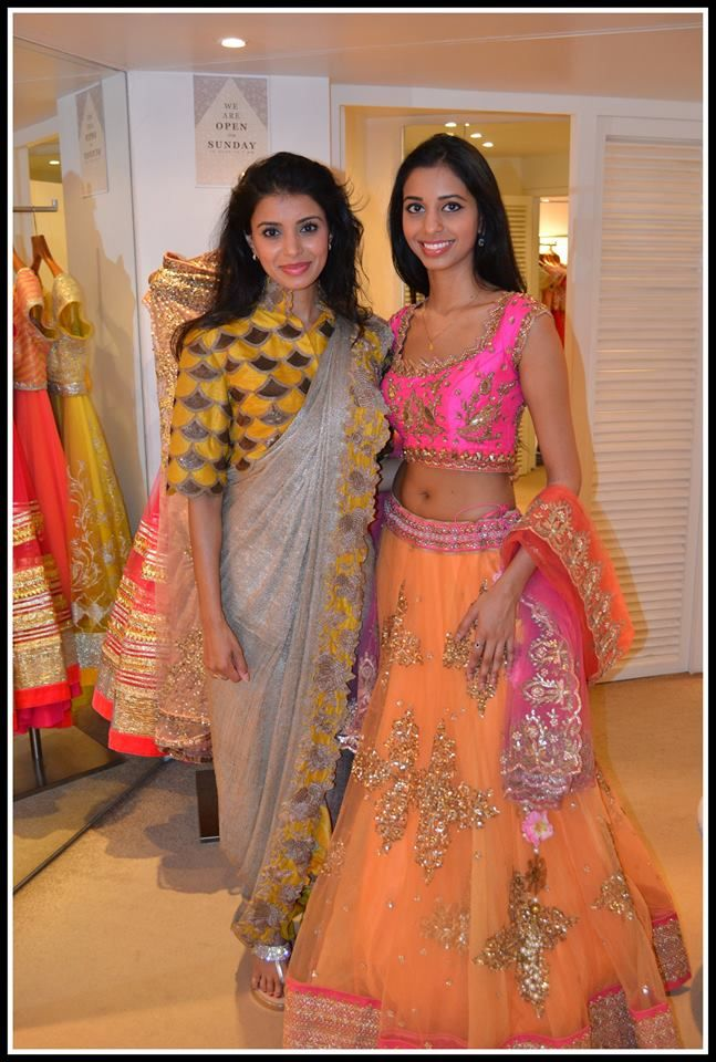 Pretty yellow and grey saree and orange and pink lehenga. Contrast saree blouse