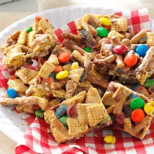 Snack Mix Squares. A fun snack mix pressed into chewy bars, this treat is popular with kids of all ages.