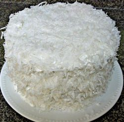 Coconut Cake with 7 minute frosting..I am going to be honest  here..I use a boxed white or butter cake and use coconut milk instead of water.. but you can not skip the 7 minute frosting .. and it is easy .. love love love it