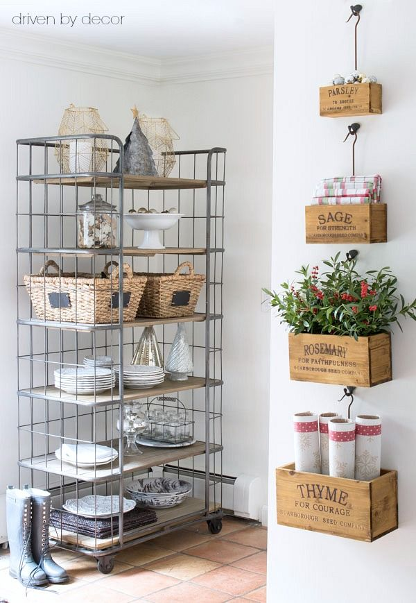 Wall mounted nesting herb crates and an open baker's rack decorated for Christmas