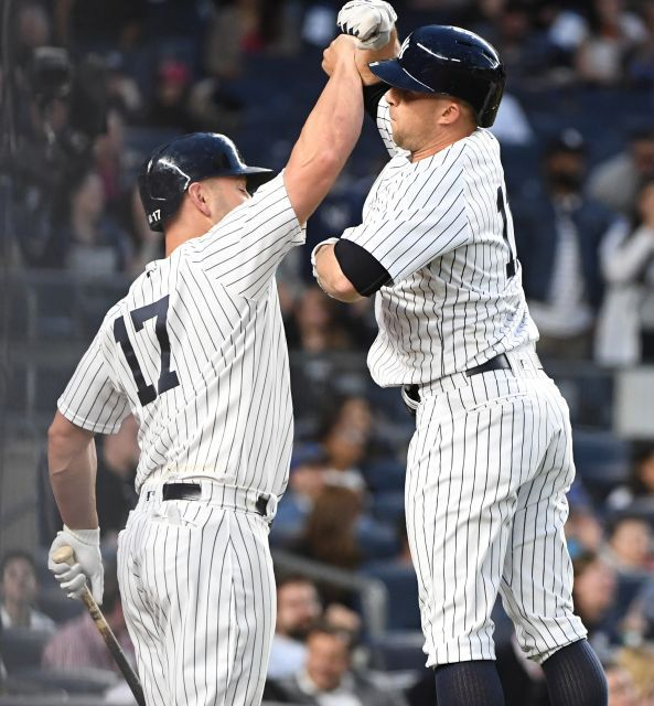 New York Yankees designated hitter Matt Holliday greets leftfielder Brett Gardner after his two-run home run against the Toronto Blue Jays during the second inning in an MLB baseball game at Yankee Stadium on Tuesday, May 2, 2017.