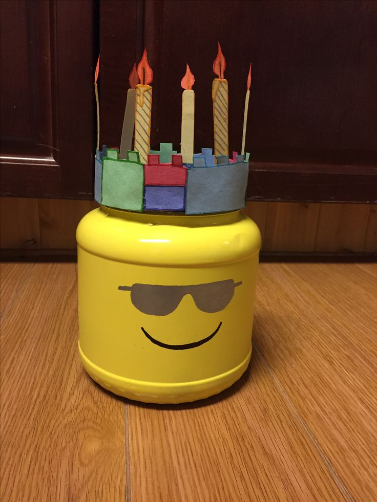 Birthday Lego man head made from a protein jar.