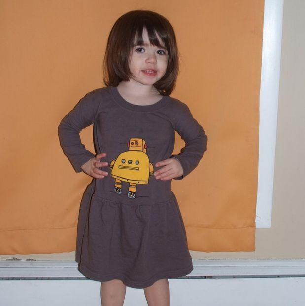 Make a toddler dress from a t-shirt.                   by domestic_engineer