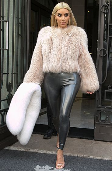 Kim Kardashian continued to show off her new platinum hair while wearing a furry coat and metallic pants during Paris Fashion Week on Saturday, Mar. 7.