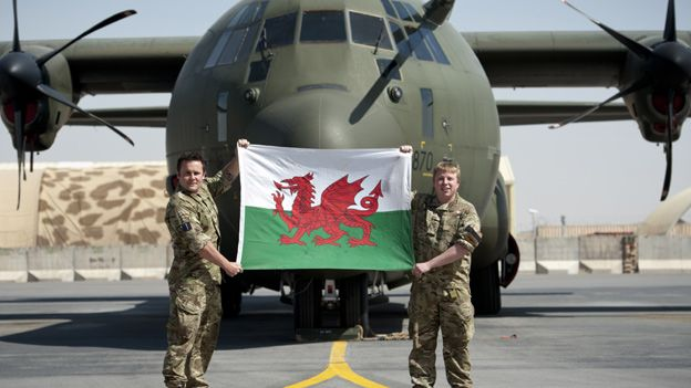 RAF technicians Leigh Jones from Aberdare and Michael Skirving from Saundersfoot, Pembrokshire, fly the flag in Kandahar, Afghanistan - 1st March St. David's Day