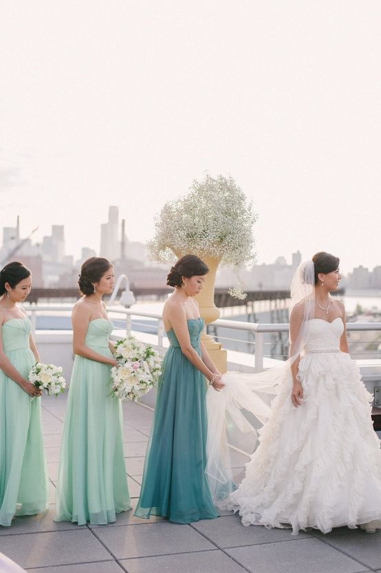 Maid of honor wears a different shade of the bridesmaid's dresses!