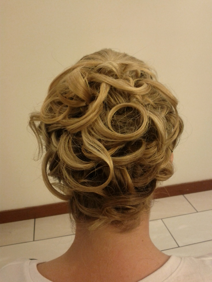 Soft curls never go out of style for brides!