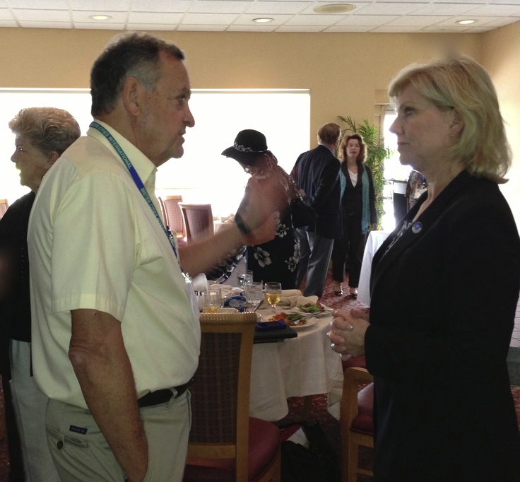 Dr. Chuck Steilen, retired dean of business at Hawaiian Pacific University and the Chinese University of Hong Kong, meets with Sister Cities international President Mary Kane at the Florida Sister Cities State Conference in Sarasota,  Dr. Steilen lead interactive discussions on business initiatives during the Friday program.