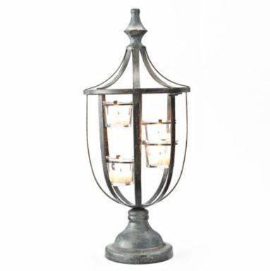Light up any space with this French-inspired tealight candle holder.