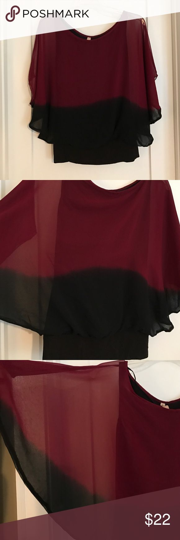 Bailey 44 Top Bailey 44 Top.  Burgundy and black sheer top with dark fitted cami. Banded waist. Great condition. Bailey 44 Tops