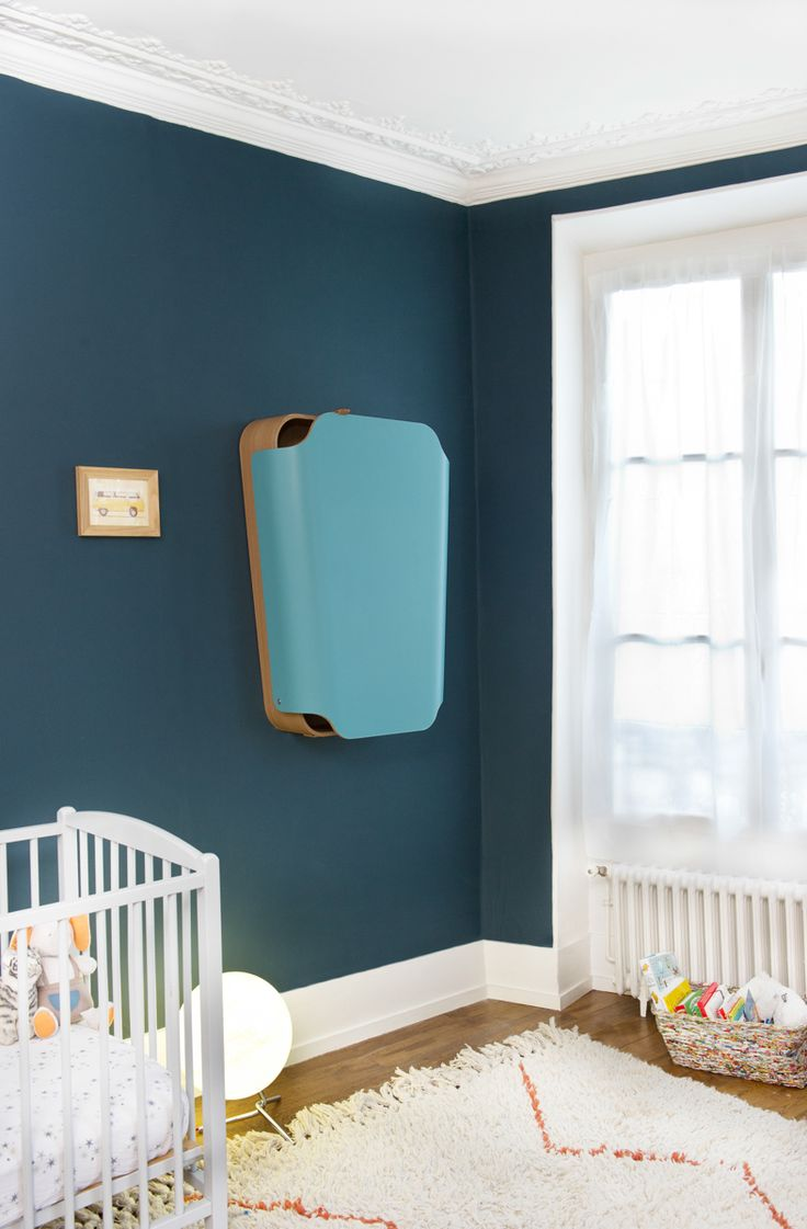 NOGA is both a changing table and shelf in one. Especially perfect for small spaces, it looks like a simple, trapezoidal shape. However, it opens up to convenient shelving as well as acting as a changing table for your baby. It can hold up to 40 lbs and comes in blue and white.