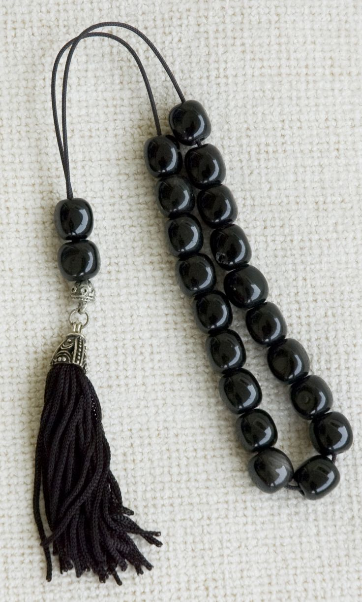Greek worry beads. Think stress ball alternative..you play with them to keep your hands busy. They come in many colors and types of beads