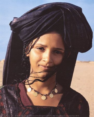 Tuareg woman, looks like she has tiny braids on one side. Might be a good model for one of the nomadic characters in the story