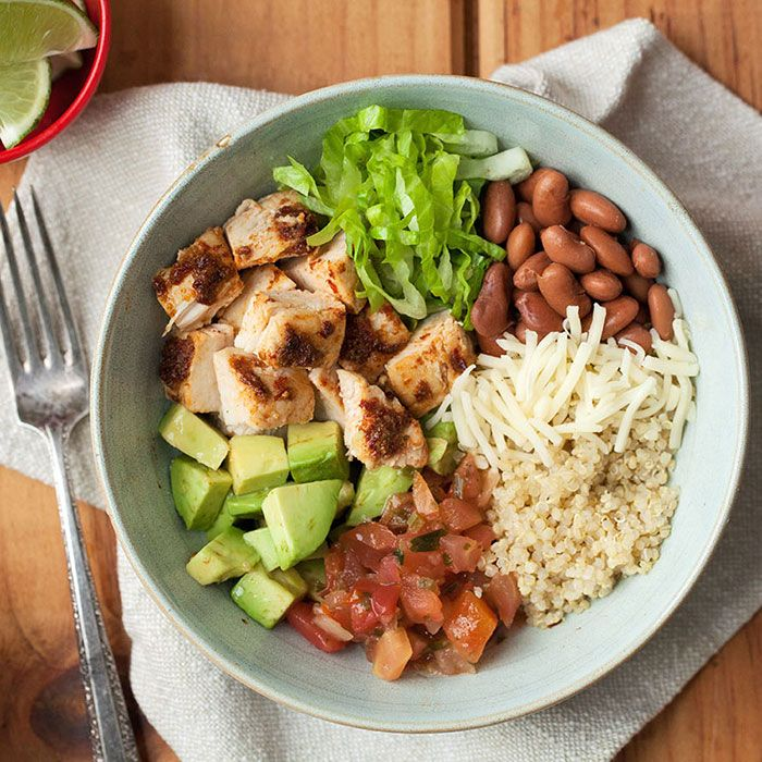 Chipotle Chicken Burrito Bowls | This chipotle-flavored burrito bowl recipe is even better than takeout and just as fast. Loading it with vegetables and using quinoa in place of rice adds nutrition for a healthy dinner.