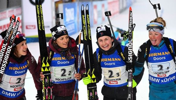 France's Anais Chevalier, Celia Aymonier, Justine Braisaz and Marie Dorin Habert react in the finish area after winning the third palce in the 2017 IBU World Championships Biathlon Women's 4x6 km relay race in Hochfilzen on February 17, 2017. / AFP / FRANCK FIFE