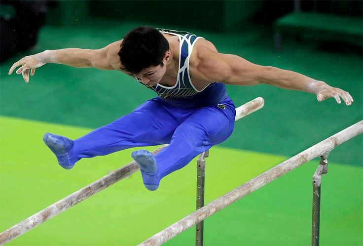 Brazil's Arthur Mariano performs on the parallel bars during the artistic…