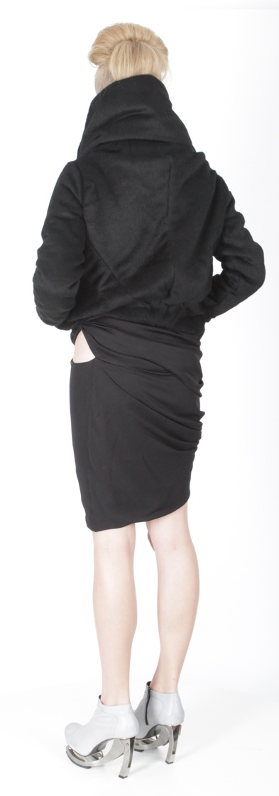 Back view: Jacket ( wool), dress (jersey), shoes ( leather, stain-less steel heel)