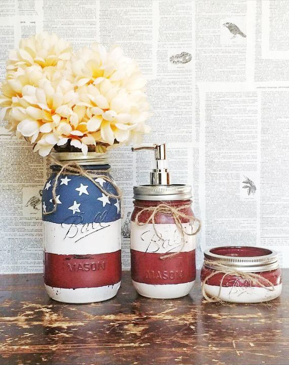 Patriotic bathroom set. American flag mason jars painted with a distressed finish. Jar sizes are 24 oz, 16 oz, and 8 oz. Hand painted and wrapped in twine. Great accent to a country bathroom.