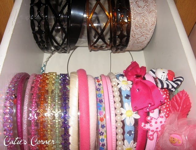 Headband Storage - there are so many cute ways to display headbands but I like this one because it's tucked in a drawer, out of sight!