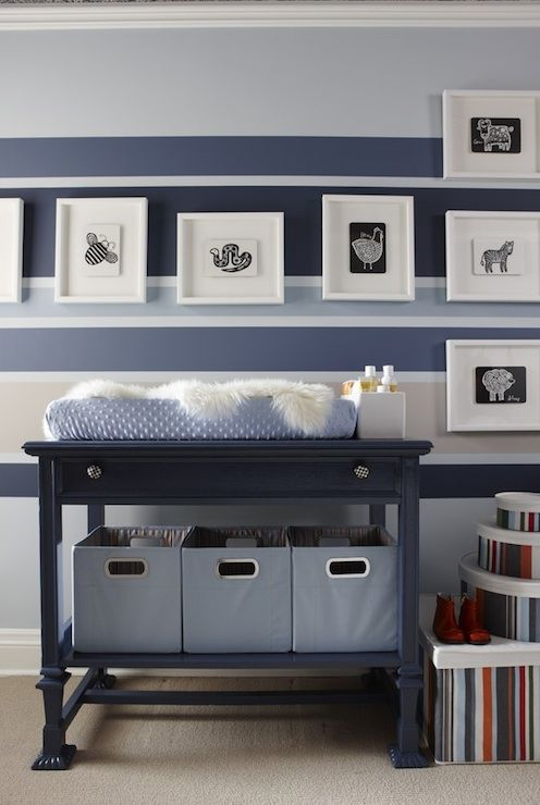 Adorable baby boy's nursery design with blue striped walls with main walls painted Para Paints Oxford, Darkest Blue Stripe - Beyond The Sea, Medium Blue Stripe -Fanfare, Beige Stripe - Cashmere, glossy blue changing table painted Para Paints Convertible and blue bins.    Para Paints Oxford
